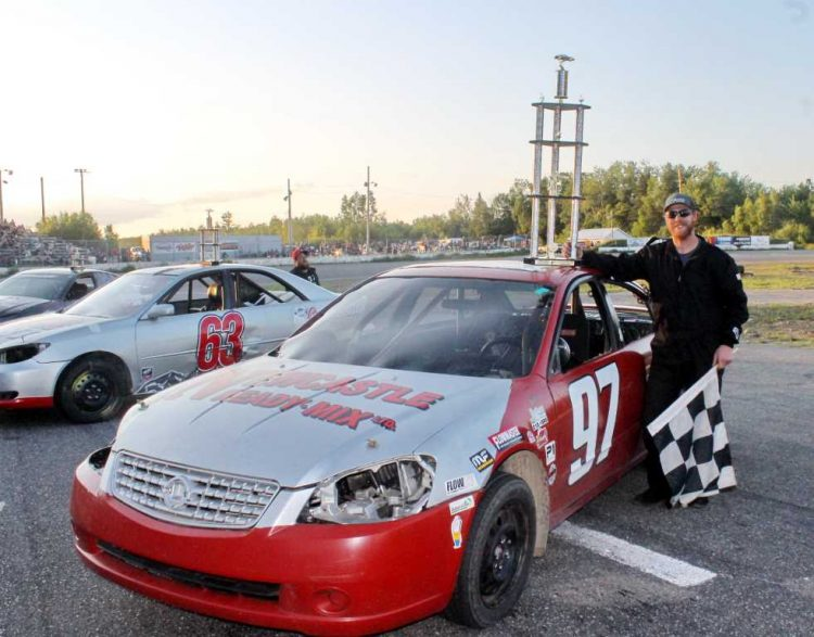 The event featured the inaugural Bomber Firecracker 50, which was won by Mark Kingston, who bested 16 Bomber cars in attendance to win the 4-foot tall trophy.  CREDIT: Speedway Miramichi