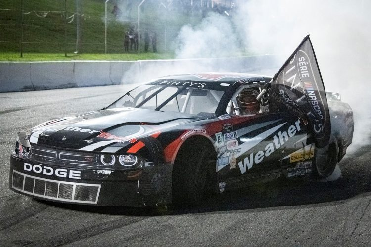 L.P. Dumoulin celebrates his third NASCAR Pinty's Series championship with a lengthy burnout at Delaware Speedway. CREDIT: Matthew Manor