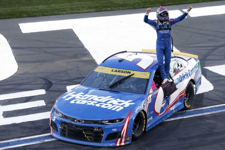 Kyle Larson, driver of the #5 HendrickCars.com Chevrolet, celebrates after winning the NASCAR Cup Series Bank of America ROVAL 400 at Charlotte Motor Speedway on October 10, 2021 in Concord, North Carolina. (Photo by Brian Lawdermilk / Getty Images)